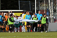 01.05.2010, Tapiolan Urheilupuisto, Espoo..Veikkausliiga 2010, FC Honka - IFK Mariehamn..Joukkueet tulevat kent?lle erotuomari Antti Munukan takana..©Juha Tamminen.