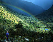 A rainbow shines over a trekking camp in Huascaran National Park, Cordillera Blanca, Andes Mountains, Peru, South America. UNESCO honored Huascaran National Park on the World Heritage List in 1985. Cordillera Blanca mountain range is in the Sierra Central of the Peruvian Andes.