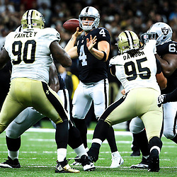 Sep 11, 2016; New Orleans, LA, USA;  Oakland Raiders quarterback Derek Carr (4) throws against the New Orleans Saints during the second half of a game at the Mercedes-Benz Superdome. The Raiders defeated the Saints 35-34. Mandatory Credit: Derick E. Hingle-USA TODAY Sports