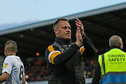 Michael Flynn applauds the traveling fans during the EFL Sky Bet League 2 second leg Play Off match between Mansfield Town and Newport County at the One Call Stadium, Mansfield, England on 12 May 2019.