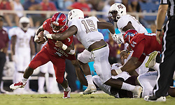 September 16, 2017 - Boca Raton, Florida, U.S. - Florida Atlantic Owls running back Devin Singletary (5) is tackled by Bethune Cookman Wildcats linebacker Marquis Hendrix (19) in Boca Raton, Florida on September 16, 2017. (Credit Image: © Allen Eyestone/The Palm Beach Post via ZUMA Wire)