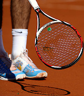 Argentina's tennis player Juan Martin Del Potro makes a butterfly get onto his racket to take it out of the court after it alighted on the ball just before he was to serve to Croatia's Marin Cilic during a 2012 Davis Cup quarterfinal match at Parque Roca stadium in Buenos Aires on April 8, 2012.  (PHOTOXPHOTO/Alejandro PAGNI)