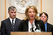 Dallas Mayor Mike Rawlings (L) and Dr. David Lakey, Commissioner of the Texas Department of State Health Services, look on while Councilmember Jennifer Staubach Gates speaks during a press conference updating the community about the Ebola patient Thomas E. Duncan in Dallas, Texas on October 6, 2014. (Cooper Neill for The Texas Tribune)