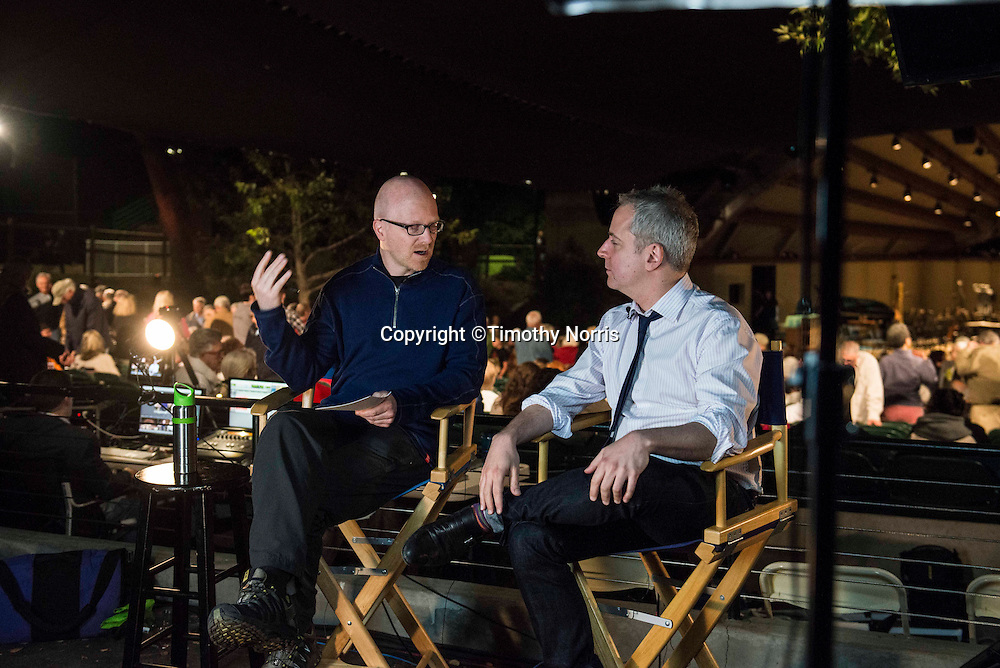 Fred Child of American Public Media interviews Music Director Jeremy Denk for the festival's webcast at the 68th Ojai Music Festival at Libbey Bowl on June 14, 2014 in Ojai, California.