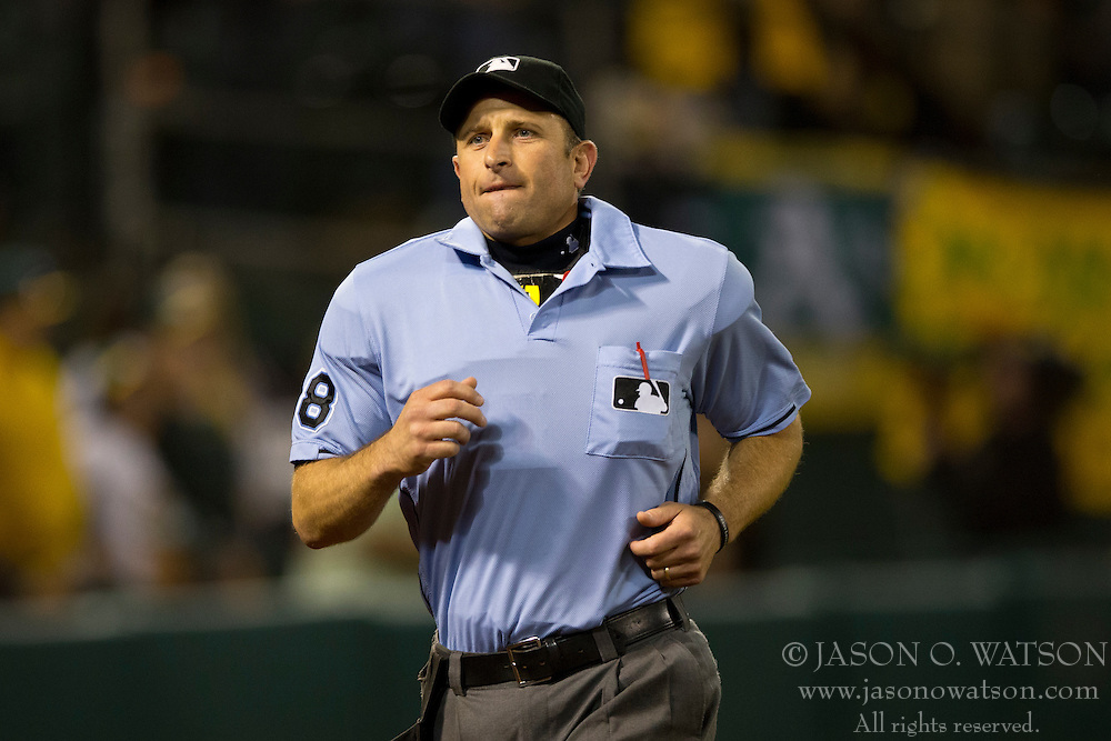 OAKLAND, CA - SEPTEMBER 23:  MLB umpire Chris Guccione #68 jogs on the field during the seventh inning between the Oakland Athletics and the Los Angeles Angels of Anaheim at O.co Coliseum on September 23, 2014 in Oakland, California. The Los Angeles Angels of Anaheim defeated the Oakland Athletics 2-0.  (Photo by Jason O. Watson/Getty Images) *** Local Caption *** Chris Guccione