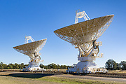 Radio telescope microwave parabolic dish antennas at CSIRO Australia Telescope Compact Array in Narrabri, New South Wales, Australia.