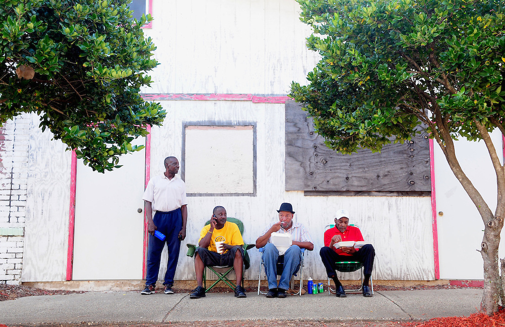From left, C.E. Cooper, Floyd Tisdale, Robert Ferrell and Ace Carter sit in the shade while eating on Saturday during the seventh annual Historic Mobile Street Festival in downtown Hattiesburg. Bryant Hawkins/The Hattiesburg American