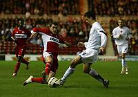 Photo: Jed Wee.<br /> Middlesbrough v FC Basle. UEFA Cup. Quarter-Final. 06/04/2006.<br /> <br /> Middlesbrough's Franck Queudrue (L) tries to tackle Basle's Bruno Berner.
