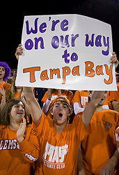 """November 21, 2009; Clemson, SC, USA;  Clemson Tigers fan holds up a sign that reads """"We're on our way to Tampa Bay"""" during the fourth quarter against the Virginia Cavaliers at Memorial Stadium.  Clemson defeated Virginia 34-21."""