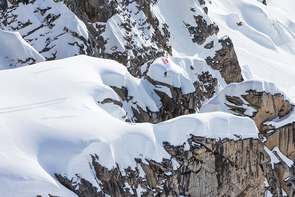 Andy Farington jumps off a large cliff while filming for the Unrideables in the Tordrillo Mountains near Anchorage, Alaska on April 27th, 2014.
