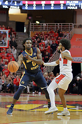09 December 2017:  Terrell Miller Jr. passes off to get past Keyshawn Evans during a College mens basketball game between the Murray State Racers and Illinois State Redbirds in  Redbird Arena, Normal IL