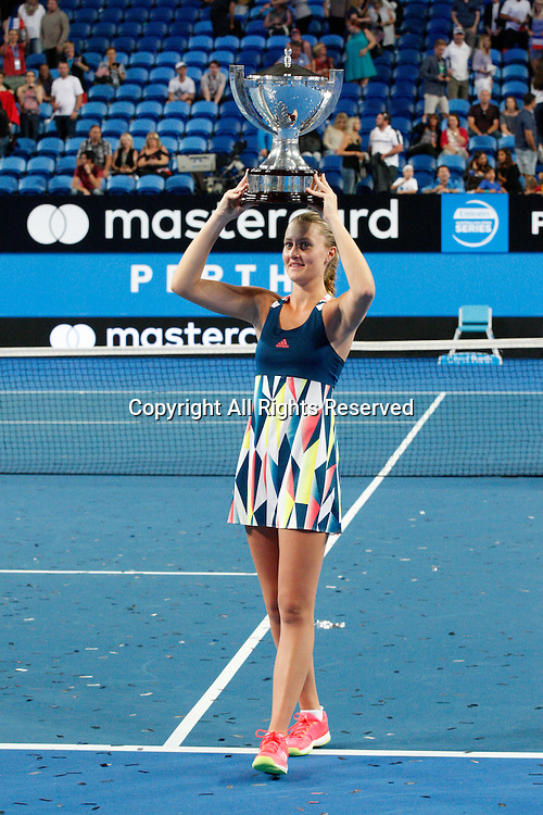 07.01.2017. Perth Arena, Perth, Australia. Mastercard Hopman Cup International Tennis tournament.  Kristina Mladenovic (FRA) holds the Hopman Cup on her head after winning the live Mixed Doubles Final against Sock/Vandeweghe (USA). Mladenovic/Gasquet won 4-1, 4-3.