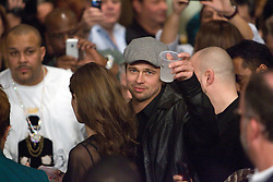K.M. CANNON/REVIEW-JOURNALActor Brad Pitt, toasts a photographer while working his way to his seat with actress Angelina Jolie before the Floyd Mayweather Jr. versus Ricky Hatton WBC welterweight boxing title fight at the MGM Grand hotel-casino in Las Vegas, Saturday, Dec. 8, 2007...