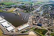 Nederland, Groningen, Delfzijl, 05-08-2014; haven Delfzijl met droogdokken en jachthaven Neptunus. Gezien naar Zeehavenkanaal, links de  Eems, stadscentrum in de voorgrond en Eemskanaal midden rechts.<br /> Delfzijl harbor with docks and marina Neptune. <br /> luchtfoto (toeslag op standard tarieven);<br /> aerial photo (additional fee required);<br /> copyright foto/photo Siebe Swart