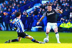 Kieran Lee of Sheffield Wednesday slides in to tackle Chris Martin of Derby County - Mandatory by-line: Ryan Crockett/JMP - 29/02/2020 - FOOTBALL - Hillsborough - Sheffield, England - Sheffield Wednesday v Derby County - Sky Bet Championship
