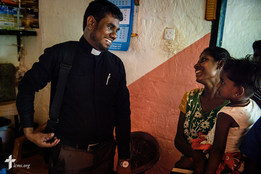 The Rev. P. Gnanakumar enjoys a moment with one of his church members as he wraps up a home visitation on the Eila rubber plantation in the Sabaragamuwa Province of Sri Lanka on Saturday, Jan. 20, 2018. LCMS Communications/ Erik M. Lunsford