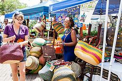 "Cherokee L. Lewis sells african market baskets.  ""Alvin's Cultural Workshop"" Cultural Fair honoring Mr. Alvin Turnbull.  Emancipation Garden.  St. Thomas, VI.  29 April 2015.  © Aisha-Zakiya Boyd"