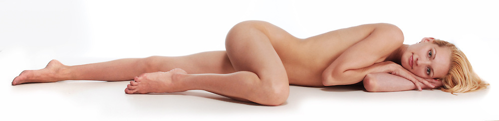 beautiful nude woman relaxing on white background, eyes closed