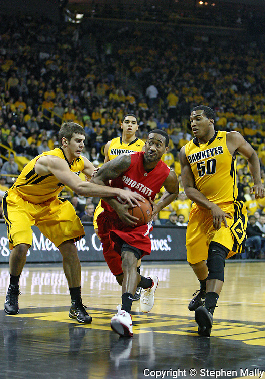 January 27, 2010: Ohio State guard/forward David Lighty (23) drives past Iowa guard Eric May (25) and Iowa forward Jarryd Cole (50) during the first half of their game at Carver-Hawkeye Arena in Iowa City, Iowa on January 27, 2010. Ohio State defeated Iowa 65-57.