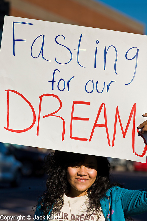 "07 DECEMBER 2010 - PHOENIX, AZ:  VANIA GUEVARA pickets the front of US Sen. John McCain's offices in Phoenix Tuesday on support of the DREAM Act. Dolores Huerta, who started working in the civil rights movement in the 1960's, threw her support behind students fasting on behalf of the DREAM Act in front of Sen. John McCain's office Tuesday. The student picked McCain's office because he used to support the DREAM Act. They hope that the US Senate will pass the DREAM Act during its ""lame duck"" session. The Senate debated and defeated similar legislation just before the November general election.    PHOTO BY JACK KURTZ"