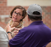 Houston ISD trustee Anna Eastman talks with an alumni during the first 2012 Bond community meeting at Davis High School, July 15, 2014.