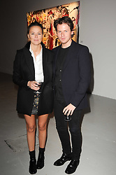Christopher Kane and Tammy Kane at a private view of Nicolas Pol's paintings entitled 'Mother of Pouacrus' held at The Dairy, Wakefield Street, London WC1 on 14th October 2010.