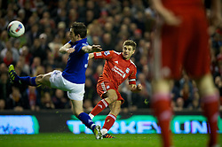 LIVERPOOL, ENGLAND - Tuesday, March 13, 2012: Liverpool's captain Steven Gerrard scores the first of his hat-trick of goals against Everton on his 400th Premier Leagie appearance during the Premiership match at Anfield. Liverpool won 3-0 and Gerrard became the first player since Ian Rush in 1982 to score a hat-trick in a Merseyside Derby. (Pic by David Rawcliffe/Propaganda)