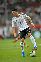 06.09.2013, Allianz Arena, Muenchen, GER, FIFA WM Qualifikation, Deutschland vs Oesterreich, Rueckspiel, im Bild Mesut Oezil (GER) am Ball Freisteller, Einzelbild, Aktion, , , Qualifikation Weltmeisterschaft Brasilien 2014 Rueckspiel , Saison 2013 2014 Muenchen Allianz-Arena, 06.09.2013 // during the FIFA World Cup Qualifier second leg Match between Germany and Austria at the Allianz Arena, Munich, Germany on 2013/09/06. EXPA Pictures © 2013, PhotoCredit: EXPA/ Eibner/ Michael Weber<br /> <br /> ***** ATTENTION - OUT OF GER *****
