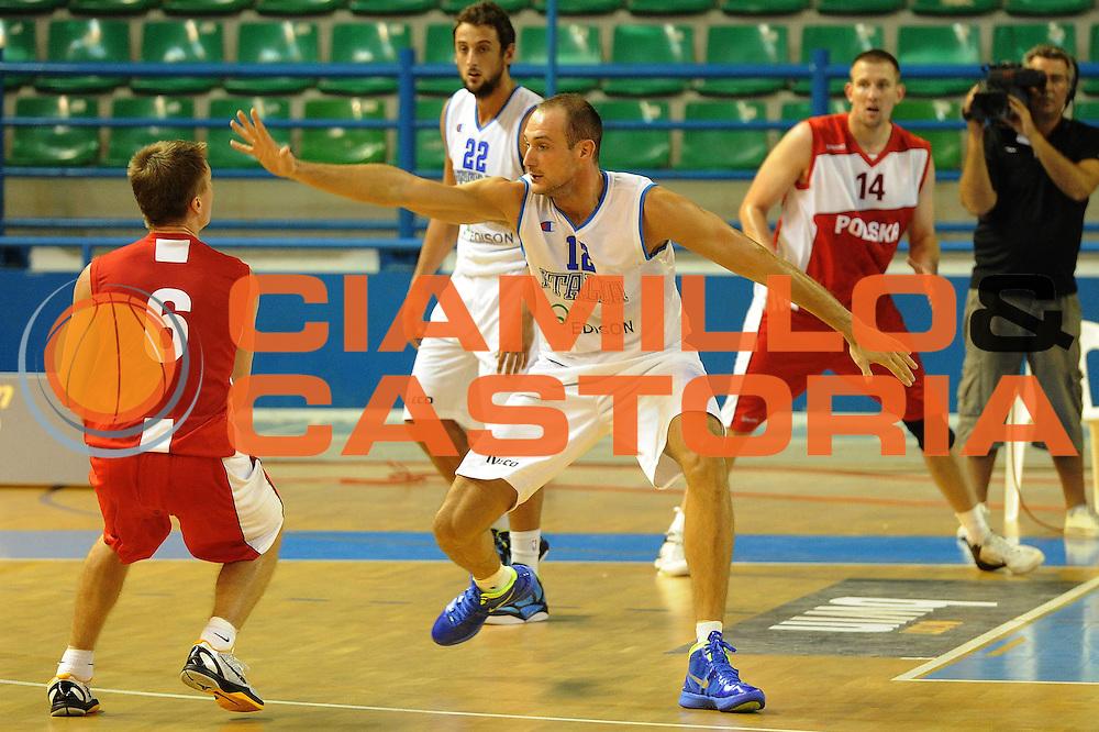 DESCRIZIONE : Cipro European Basketball Tour Italia Polonia Italy Poland<br /> GIOCATORE : Marco Cusin<br /> CATEGORIA : Difesa<br /> SQUADRA : Nazionale Italia Uomini <br /> EVENTO : European Basketball Tour <br /> GARA : Italia Polonia <br /> DATA : 07/08/2011 <br /> SPORT : Pallacanestro <br /> AUTORE : Agenzia Ciamillo-Castoria/GiulioCiamillo<br /> Galleria : Fip Nazionali 2011 <br /> Fotonotizia :  Cipro European Basketball Tour Italia Polonia Italy Poland<br /> Predefinita :