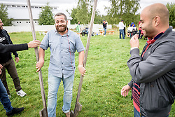 """13 August 2016, Norrbyskär, Umeå, Sweden: Adnan Al Mousa, a Syrian refugee recently arrived in Sweden, practices walking on stilts, during the Kul-Tur Fest (""""Culture Festival""""). Muhammad Al Hamid (right), from Syria looks on. The event, which attracted hundreds of people, set out to offer a meeting place for Swedish culture and new forms of cultural expression, and featured baking competitions, dance workshops, book discussions, fingernail painting and music, among other things."""