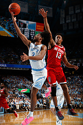 CHAPEL HILL, NC - FEBRUARY 05: Coby White #2 of the North Carolina Tar Heels drives to the basket during a game against the North Carolina State Wolfpack on February 05, 2019 at the Dean Smith Center in Chapel Hill, North Carolina. North Carolina won 113-96. North Carolina wore retro uniforms to honor the 50th anniversary of the 1967-69 team. (Photo by Peyton Williams/UNC/Getty Images) *** Local Caption *** Coby White