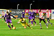 James McKeown (1) of Grimsby Town in action as Elliot Embleton (22) of Grimsby Town gets the ball out of danger during the EFL Sky Bet League 2 match between Exeter City and Grimsby Town FC at St James' Park, Exeter, England on 29 December 2018.