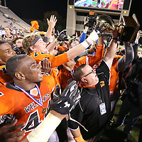 Adam Robison   BUY AT PHOTOS.DJOURNAL.COM<br /> Calhoun City Head Coach Perry Liles lifts up the MHSAA Class 2A Football State Chanpionship Trophy with his team after defeating Bay Springs 22-8 Friday in Strakville.