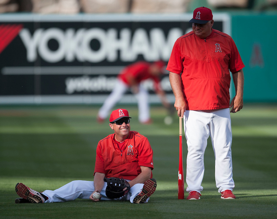 Gary DiSarcina smiles after fielding a ball during batting practice next to manager Mike Scioscia before the Angels game against the Chicago Cubs at Angel Stadium Tuesday.<br /> <br /> ///ADDITIONAL INFO:   <br /> <br /> angels.0406.kjs  ---  Photo by KEVIN SULLIVAN / Orange County Register  --  4/5/16<br /> <br /> The Los Angeles Angels take on the Chicago Cubs Tuesday at Angel Stadium.<br /> <br /> <br />  4/5/16