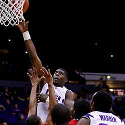 November 30, 2010; Baton Rouge, LA, USA;  LSU Tigers forward Malcolm White (5) shoots over Houston Cougars guard Adam Brown (31) during the first half at the Pete Maravich Assembly Center.  Mandatory Credit: Derick E. Hingle