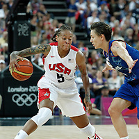 11 August 2012: USA Seimone Augustus drives goes for the crossover past Celine Dumerc during 86-50 Team USA victory over Team France, during the Women's Gold Medal Game, at the North Greenwich Arena, in London, Great Britain.