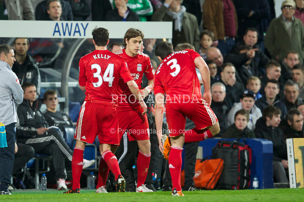 LONDON, ENGLAND - Wednesday, March 21, 2012: Liverpool's injured Martin Kelly is replaced by Sebastian Coates during the Premiership match against Queens Park Rangers at Loftus Road. (Pic by David Rawcliffe/Propaganda)