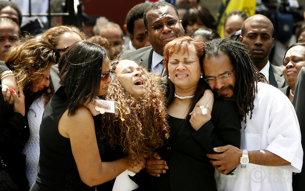 Annette Whyte (6th from R) grieves with friends and family after the funeral service for her son, United States Marine Lance Cpl. Nicholas J. Whyte, at the Bedford Central Presbyterian Church in Brooklyn, New York on Friday 30 June 2006. Whyte was killed on 21 June 2006 while serving in Iraq.