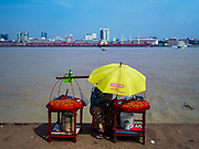 20 NOVEMBER 2017 - YANGON, MYANMAR: A fruit vendor on the Dala Ferry pier. Tens of thousands of commuters ride the ferry every day. It brings workers into Yangon from Dala, a working class community across the river from Yangon. A bridge is being built across the river, downstream from the ferry to make it easier for commuters to get into the city.     PHOTO BY JACK KURTZ