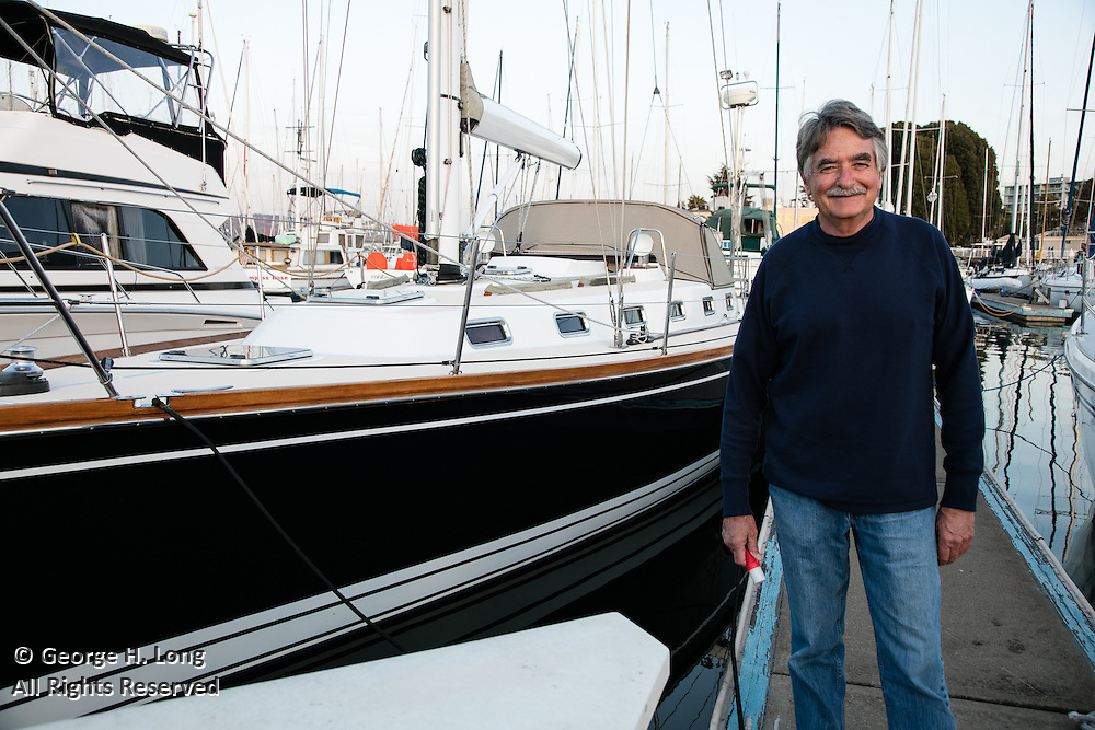 Stephen Blitch with his sailboat, Prime Number, docked in Oakland, California