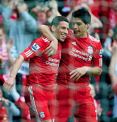LIVERPOOL, ENGLAND - Saturday, April 23, 2011: Liverpool's Maximiliano Ruben Maxi Rodriguez celebrates with team-mate Luis Alberto Suarez Diaz after completing his hat-trick, scoring his side's fourth goal against Birmingham City during the Premiership match at Anfield. (Photo by David Rawcliffe/Propaganda)