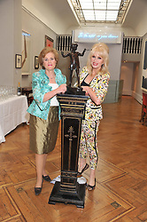 Left to right, CATHY AGNEW Development Director at Peter Pan Moat Brae Trust and JOANNA LUMLEY at a reception to unveil the Limited Centenary Edition of Sir George Frampton's statuette of Peter Pan in aid of the Moat Brae Charity held at The Fine Art Society, 148 New Bond Street, London on 1st May 2012.