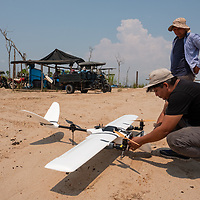 Martín Pillaca, GIS Specialist at CINCIA, helps prepare the fixed wing drone for its next mapping flight over La Pampa. Following Peru's February 2019 militarized crackdown on illegal and unofficial alluvial gold mining in the La Pampa region of Madre de Dios, Wake Forest University's Puerto Maldonado-based Centro de Innovación Científica Amazonia (CINCIA), a leading research institution for the development of technological innovation for biological conservation and environmental restoration in the Peruvian Amazon, is applying years of scientific research and technical experience related to understanding mercury contamination and managing Amazonian ecosystems. What they learn will help guide urgent remediation, restoration, and reforestation efforts that can also serve as models for how we address the tropic's most dramatically devastated landscapes around the world. La Pampa, Madre de Dios, Peru.