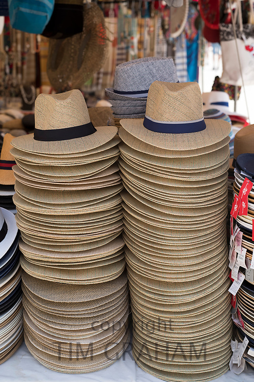 Panama and straw sun hats on display for sale on market stall at the old street market - Mercado -  in Ortigia, Syracuse, Sicily