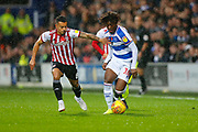 Rangers Midfielder Eberechi Eze & Brentford's Midfielder Nico Yennaris during the EFL Sky Bet Championship match between Queens Park Rangers and Brentford at the Loftus Road Stadium, London, England on 10 November 2018.