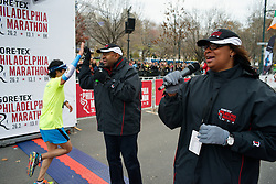 Michael Nutter (middle), outgoing Mayor of Philadelphia and Desiree Peterkin-Bell, Race Director, cheer on and high-five runenrs as they go past the finish line of the November 22, 2015 Philadelphia Marathon in Center City Philadelphia, PA. (Photo by Bastiaan Slabbers)<br /> <br /> Download and license photo: http://www.istockphoto.com/photo/philadelphia-marathon-finish-line-79534511
