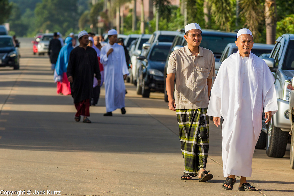 Men walk into Eid al-Fitr services at Songkhla Central Mosque in Songkhla province of Thailand. Eid al-Fitr is also called Feast of Breaking the Fast, the Sugar Feast, Bayram (Bajram), the Sweet Festival and the Lesser Eid, is an important Muslim holiday that marks the end of Ramadan, the Islamic holy month of fasting.