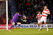 Fine stop from Doncaster Rovers goalkeeper Thorsten Stuckmann  during the The FA Cup third round match between Doncaster Rovers and Stoke City at the Keepmoat Stadium, Doncaster, England on 9 January 2016. Photo by Simon Davies.