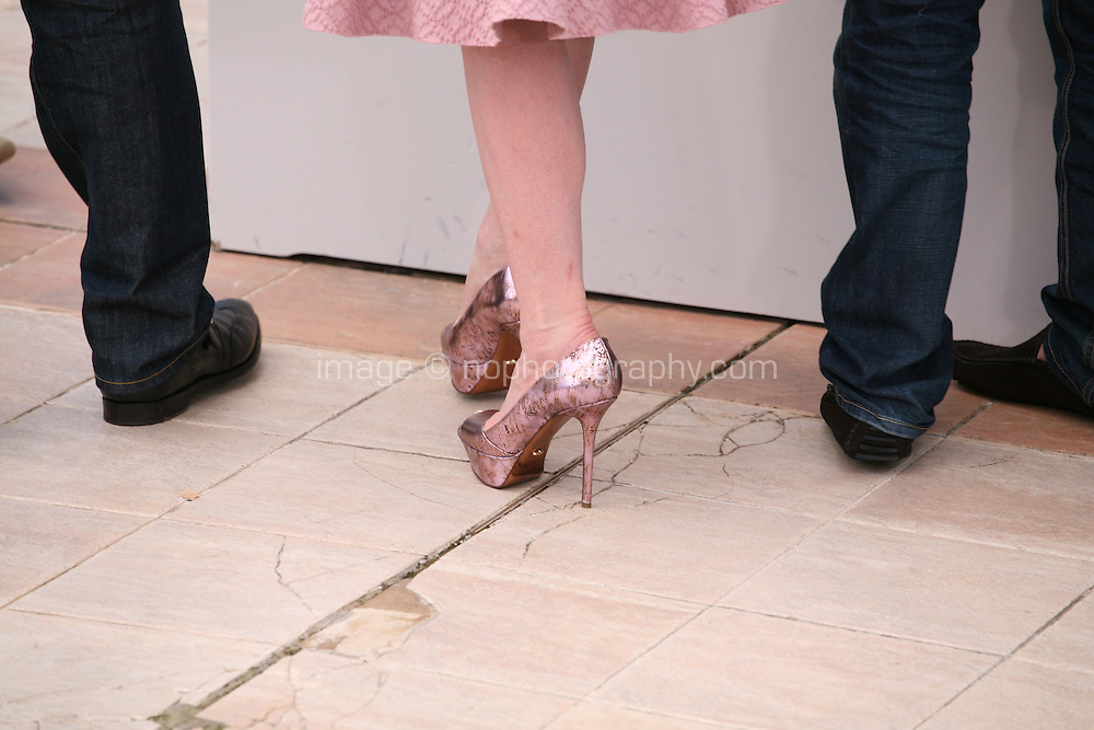 Sparkly pink shoes worn by Arsinée Khanjian at the Jury De La Cinéfondation photocall at the 65th Cannes Film Festival France. Wednesday 23rd May 2012 in Cannes Film Festival, France.