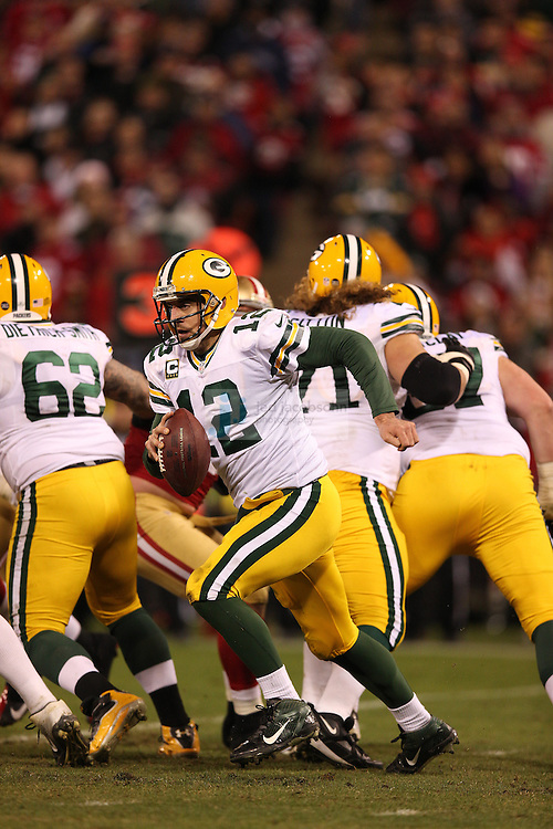 Green Bay Packers quarterback Aaron Rodgers (12) runs during a NFL Divisional playoff game against the San Francisco 49ers at Candlestick Park in San Francisco, Calif., on Jan. 12, 2013. The 49ers defeated the Packers 45-31. (AP Photo/Jed Jacobsohn)